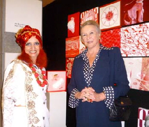 "Her Royal Highness Maria Gabriella of Savoy and Chris Bleicher with the neon object ""Innocent LOVE"" during the grand opening of ART MONACO'14 in GRIMALDI FORUM"